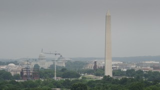 AX74_085 - 5K stock footage aerial video of Washington Monument and United States Capitol in Washington DC
