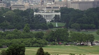 AX74_087 - 5K stock footage aerial video of The White House and the South Lawn in Washington DC