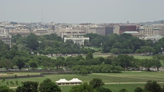 AX74_096 - 5K stock footage aerial video of The White House seen from across the National Mall in Washington DC