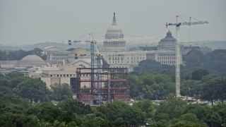 AX74_098 - 5K stock footage aerial video of the United States Capitol, reveal the Washington Monument in Washington DC