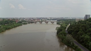 AX74_103 - 5K stock footage aerial video of Francis Scott Key Bridge spanning the Potomac River in Washington DC