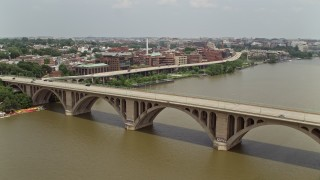 AX74_105 - 5K stock footage aerial video tracking light traffic on the Francis Scott Key Bridge in Washington DC
