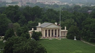 AX74_111 - 5K stock footage aerial video of tour groups on the front steps of Arlington House at Arlington National Cemetery, Washington DC