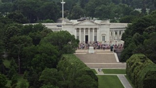 AX74_112 - 5K stock footage aerial video of tour groups at the Tomb of the Unknown Soldier at Arlington National Cemetery, Washington DC