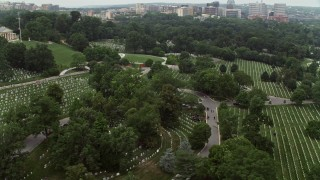 AX74_114 - 5K stock footage aerial video flying by rows of grave stones at Arlington National Cemetery, Washington DC