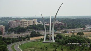 AX74_116 - 5K stock footage aerial video flying by the United States Air Force Memorial at Arlington National Cemetery, Washington DC
