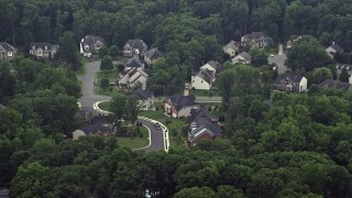 AX74_130 - 5K stock footage aerial video of large, upscale homes on quiet streets in Springfield, Virginia