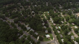 AX74_133 - 5K stock footage aerial video tilting to a bird's eye view of a suburban neighborhood in Springfield, Virginia