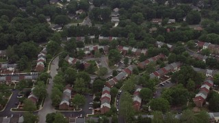 AX74_134 - 5K stock footage aerial video tilting to a bird's eye view of row houses in Springfield, Virginia