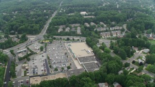 AX74_137 - 5K stock footage aerial video flying over the Burke Town Plaza and row houses in Burke, Virginia