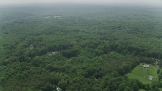 AX74_144 - 5K stock footage aerial video flying over upscale homes surrounded by forest in Fairfax Station, Virginia