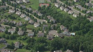 AX75_006 - 5K stock footage aerial video of a quiet suburban neighborhood in Manassas, Virginia