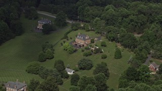 AX75_010 - 5K stock footage aerial video approaching and tilting down to isolated home in the country, Clifton, Virginia