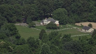AX75_013 - 5K stock footage aerial video of an isolated home in the country with horses in Fairfax Station, Virginia