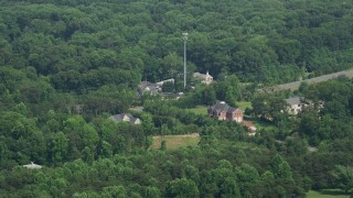 AX75_014 - 5K stock footage aerial video of small rural churches and homes by Ox Road in Fairfax Station, Virginia