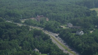 AX75_017 - 5K stock footage aerial video of traffic passing a church and rural homes by Ox Road in Fairfax Station, Virginia