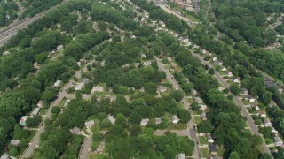 AX75_024 - 5K stock footage aerial video of a bird's eye of Springfield, Virginia suburban homes, and reveal small shops