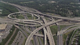 AX75_026E - 5K stock footage aerial video approaching the I-495 / I-395 freeway interchange with light traffic in Springfield, Virginia