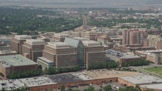 AX75_036 - 5K stock footage aerial video flying by the United States Patent and Trademark Office and office buildings in Alexandria, Virginia