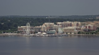 AX75_039 - 5K stock footage aerial video approaching marina and Capitol Wheel at National Harbor, Maryland