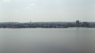 AX75_043 - 5K stock footage aerial video of office buildings across the Potomac River in Alexandria, Virginia