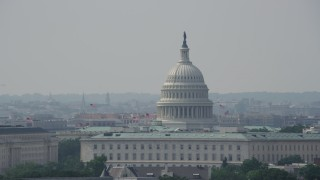 AX75_055 - 5K stock footage aerial video of United States Capitol dome and top of the Cannon House Office Building in Washington DC
