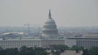 AX75_056 - 5K stock footage aerial video of the United States Capitol dome behind Cannon House Offices and James Madison Building in Washington DC