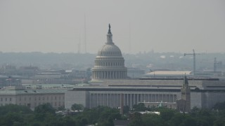 AX75_057 - 5K stock footage aerial video of the United States Capitol dome behind the James Madison Building in Washington DC