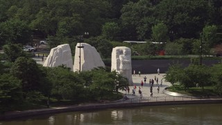 AX75_082 - 5K stock footage aerial video of tourists visiting the Martin Luther King Jr. National Memorial in Washington DC