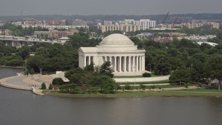 AX75_086 - 5K stock footage aerial video flying by the Jefferson Memorial, revealing the Jefferson Statue inside in Washington DC
