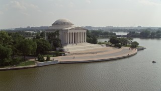 AX75_087 - 5K stock footage aerial video flying by the Jefferson Memorial to reveal the Jefferson statue inside in Washington DC