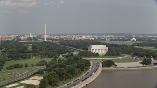 AX75_090 - 5K stock footage aerial video orbiting  Lincoln Memorial to reveal the National Mall in Washington DC