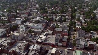 AX75_093 - 5K stock footage aerial video flying over buildings in Georgetown, Washington DC