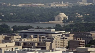 AX75_094 - 5K stock footage aerial video of the Jefferson Memorial seen from Georgetown, Washington DC
