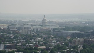 AX75_105 - 5K stock footage aerial video of the United States Capitol seen from across Washington DC