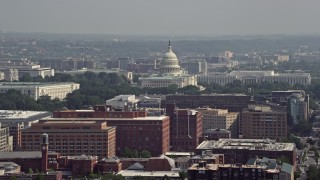 AX75_110 - 5K stock footage aerial video of office buildings, the United States Capitol, and the Rayburn House Office Building in Washington DC