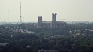 AX75_114 - 5K stock footage aerial video of the Washington National Cathedral in Washington DC