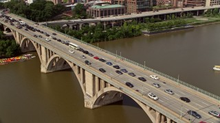 AX75_122 - 5K stock footage aerial video of heavy traffic on the Francis Scott Key Bridge in Washington DC