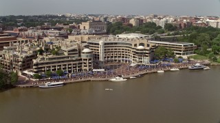 AX75_123 - 5K stock footage aerial video of Washington Harbour condo complex by the Potomac River in Georgetown, Washington DC