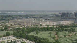 AX75_127 - 5K stock footage aerial video of The Pentagon seen while flying over Arlington National Cemetery in Washington DC