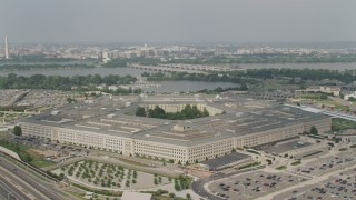AX75_129 - 5K stock footage aerial video orbiting The Pentagon in Washington DC, with Washington Monument and Potomac in the background
