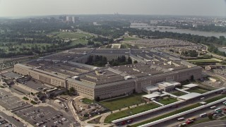 AX75_130E - 5K stock footage aerial video orbiting The Pentagon in Washington DC with Potomac River in the background