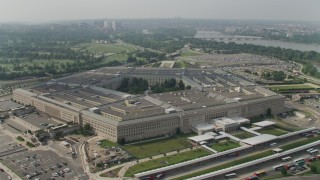 AX75_131 - 5K stock footage aerial video orbiting The Pentagon in Washington DC, with Arlington National Cemetery in the background