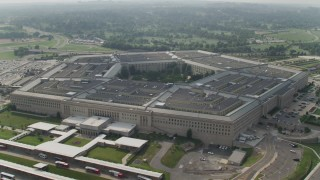 AX75_132 - 5K stock footage aerial video orbiting around The Pentagon in Washington DC