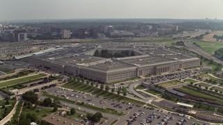 AX75_133E - 5K stock footage aerial video orbiting around The Pentagon in Washington DC