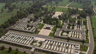AX75_135 - 5K stock footage aerial video approaching a monument at Arlington National Cemetery in Washington DC