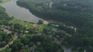 AX75_160 - 5K stock footage aerial video flying over homes around the shore of Lake Royal in Fairfax, Virginia