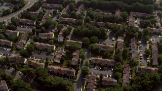 AX75_162 - 5K stock footage aerial video tilting to a bird's eye view of row houses in Fairfax, Virginia