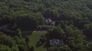 AX75_166 - 5K stock footage aerial video tilting to a bird's eye view of a spacious mansion in Fairfax Station, Virginia