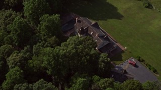 AX75_167 - 5K stock footage aerial video tracking upscale home by wide green fields in Fairfax Station, Virginia